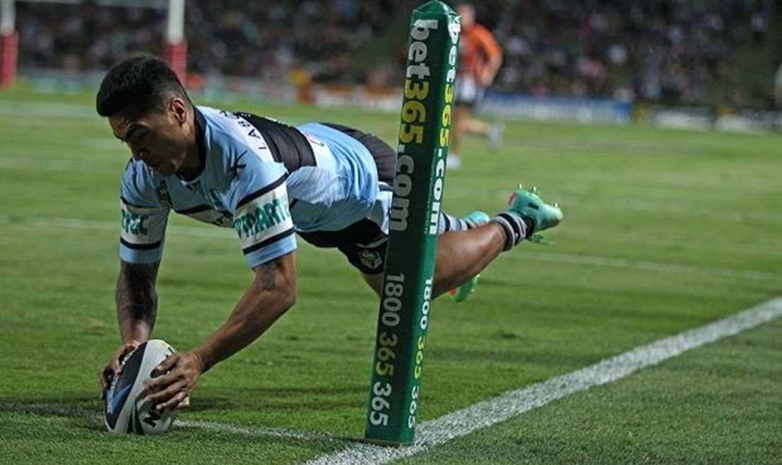 Photo by Colin Whelan copyright © nrlphotos.com :          Sosaia FEki scores in the corner for the Sharks                     NRL Rugby League, Round 25 North Queensland Cowboys v Cronulla Sharks at Townsville, Monday September 1st 2014