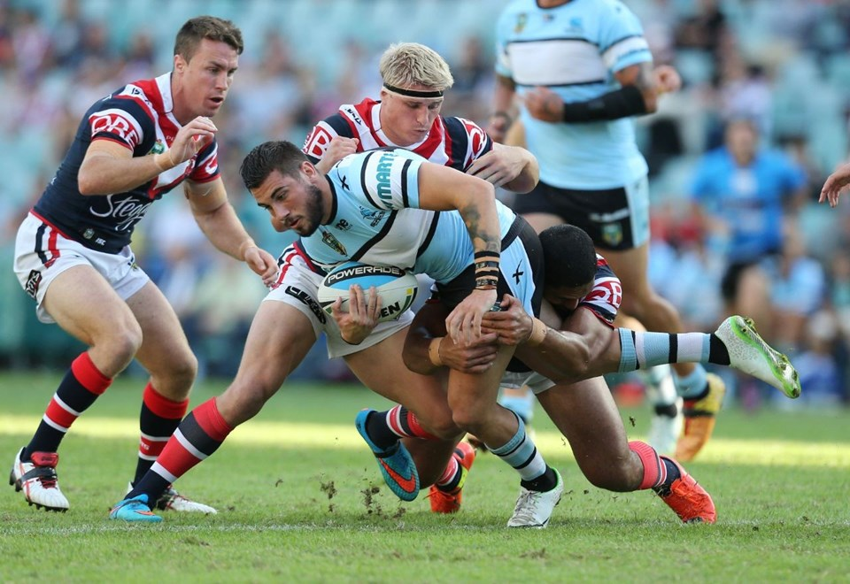 Jack Bird Wrapped up :Digital Image by Grant Trouvile © NRLphotos  : 2015 NRL Round 5 - Sydney Roosters v Cronulla Sharks At Allianz Stadium April 5th  2015.