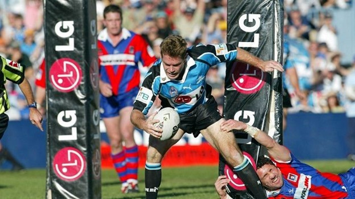 Brett Kimmorley goes in to score as Robbie O'Davis collides with the post - NRL Cronulla Sharks v Newcastle Knights at Shark Park, Sunday August 11th 2002.  Digital Image by Colin Whelan © Action Photographics