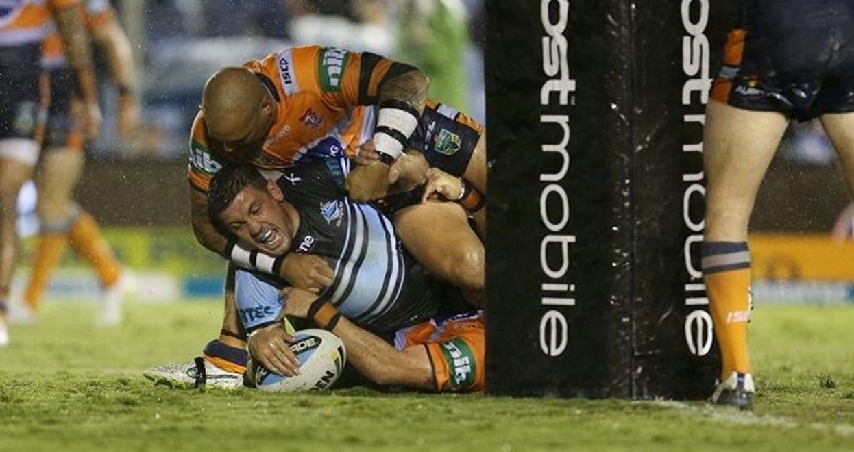 Chris Heighington scores and cops a high shot from Jeremy Smith : Digital Image Grant Trouville  © nrlphotos : NRL Rugby League - Round 6 : Cronulla Sharks v Newcastle Knights at Remondis Stadium, Friday April 10th 2015.