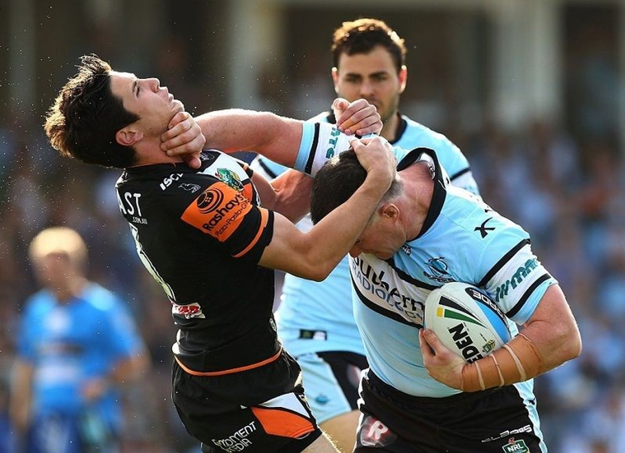 Paul Gallen of the Sharks and Mitchell Moses of the Tigers during the Round 24 NRL match between the Cronulla Sutherland Sharks and Wests Tigers at Remondis Stadium on August 16, 2015 in Canberra, Australia. Digital Image by Mark Nolan.