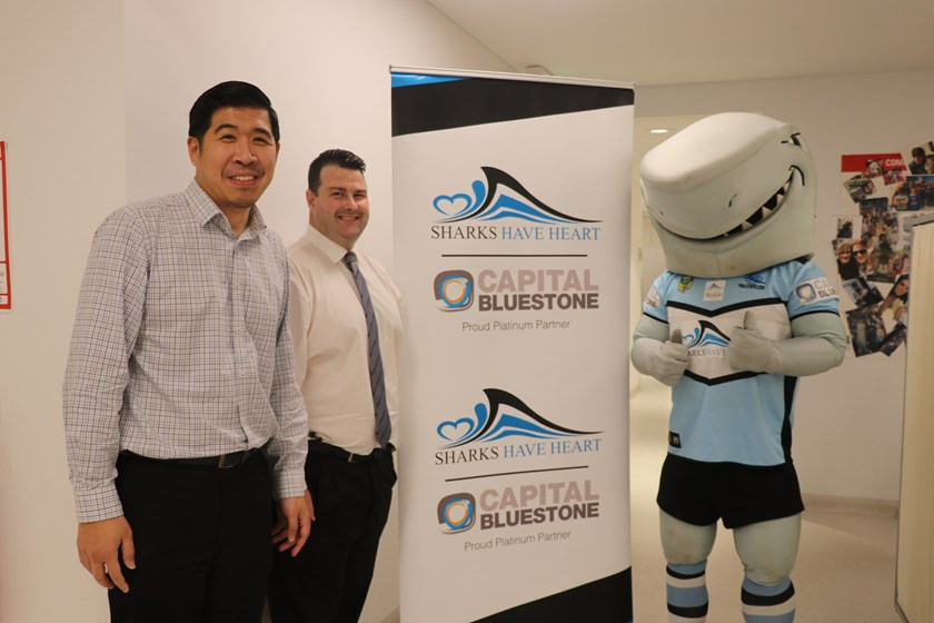 Sharks member Teddy Haryjanto, with Dean Merrin from Stewart Toyota, and Reefy, at the Shire Donor Centre in Miranda