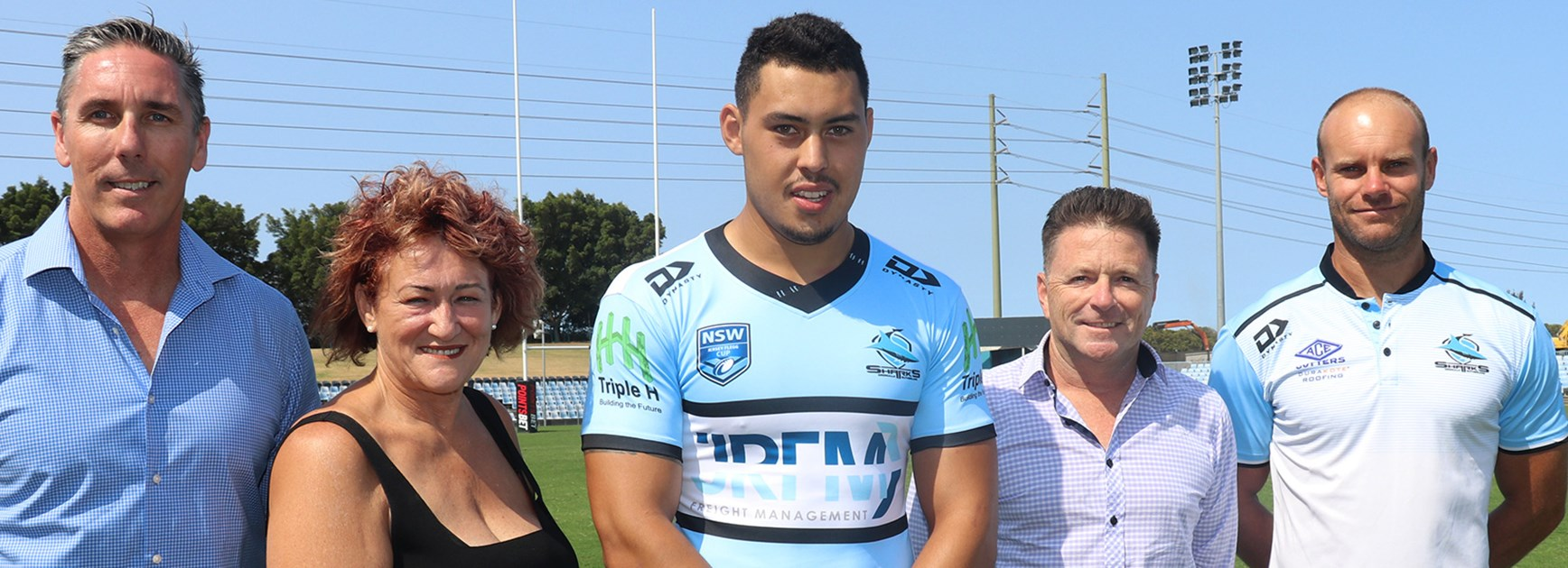 From left: Wayne Miller and Sue Ryan from John Ryan Freight Management, Jensen Taumopeau, David Harrop, Triple H, and Sharks Jersey Flegg coach Daniel Holdsworth