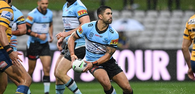 Sharks slip and slide to loss in the wet